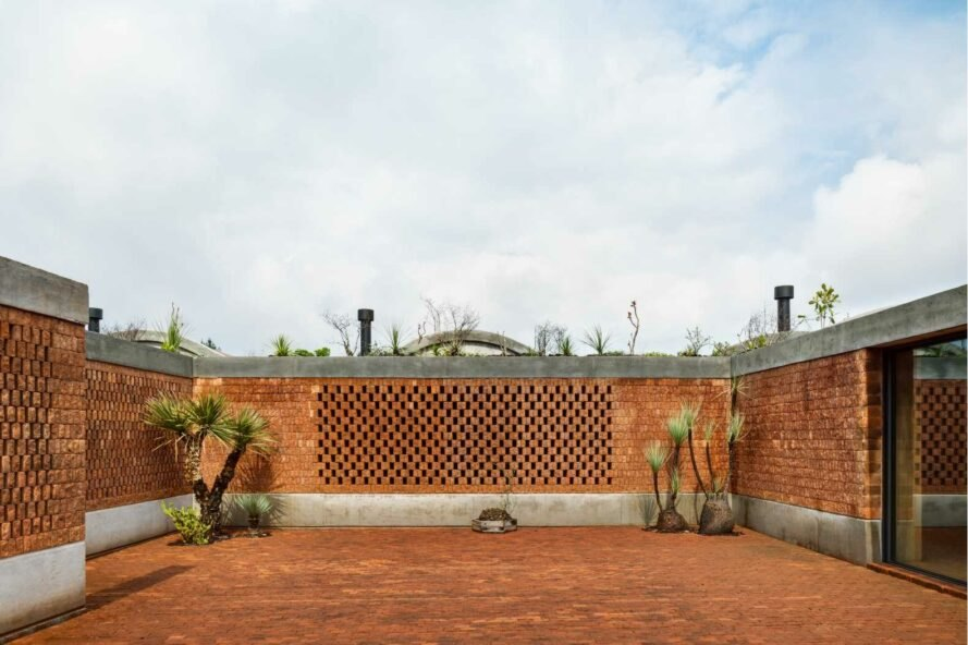 open-air courtyard with brick walls