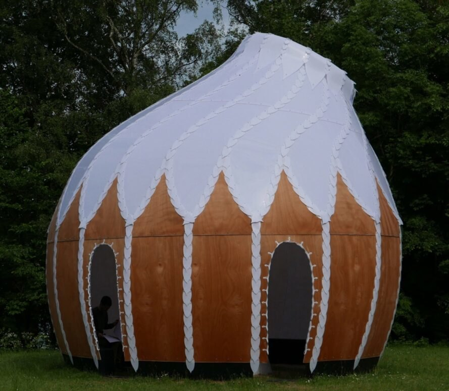 round, pod-like shelter with white roof