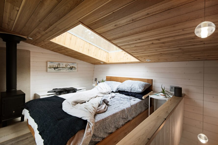 large bed under a skylight