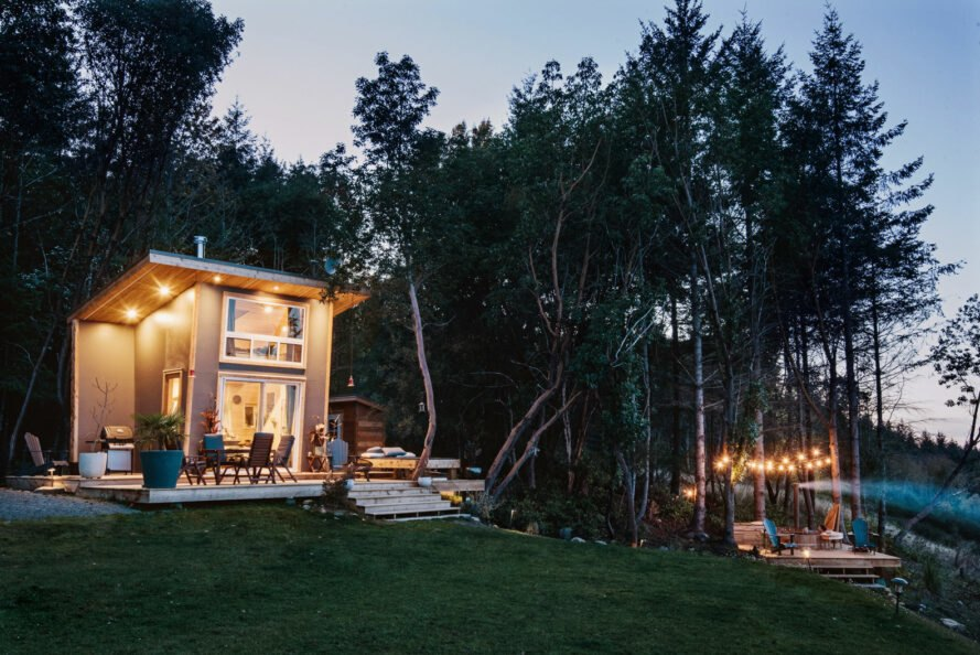 tiny home lit up at dusk