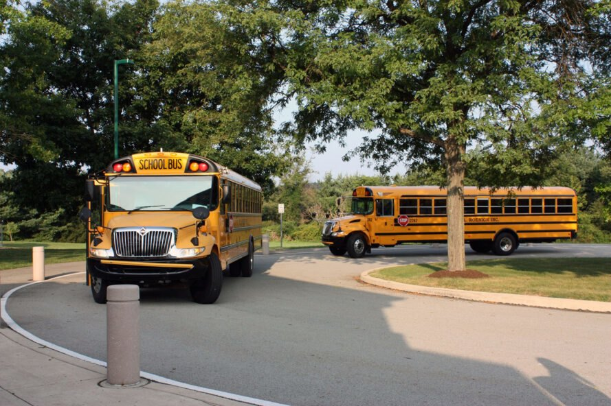 school buses pulling into driveway