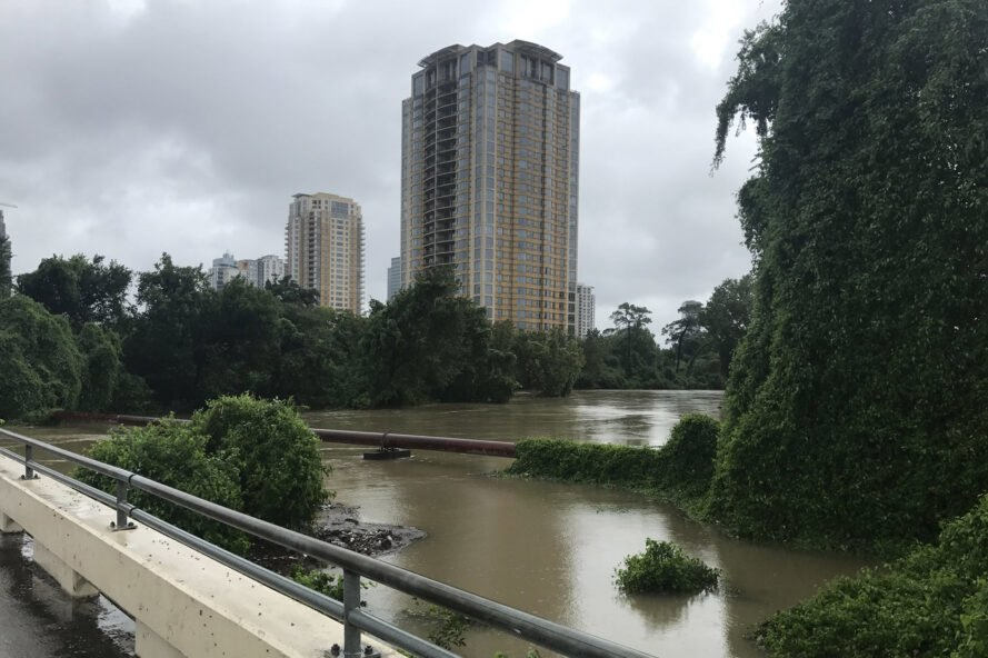 flooded river with building in distance