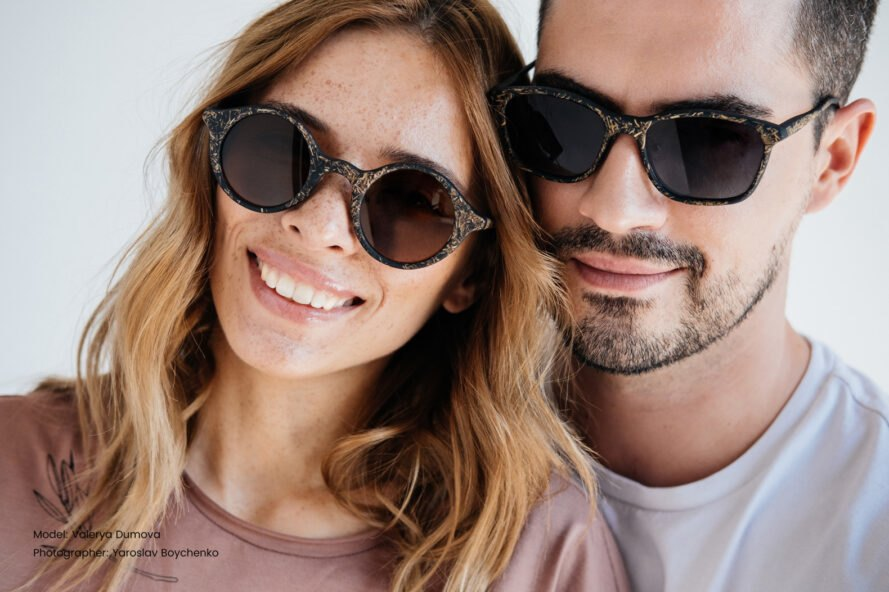 two people wearing brown sunglasses