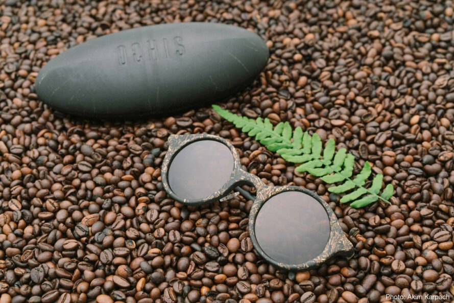 brown sunglasses on a bed of coffee beans