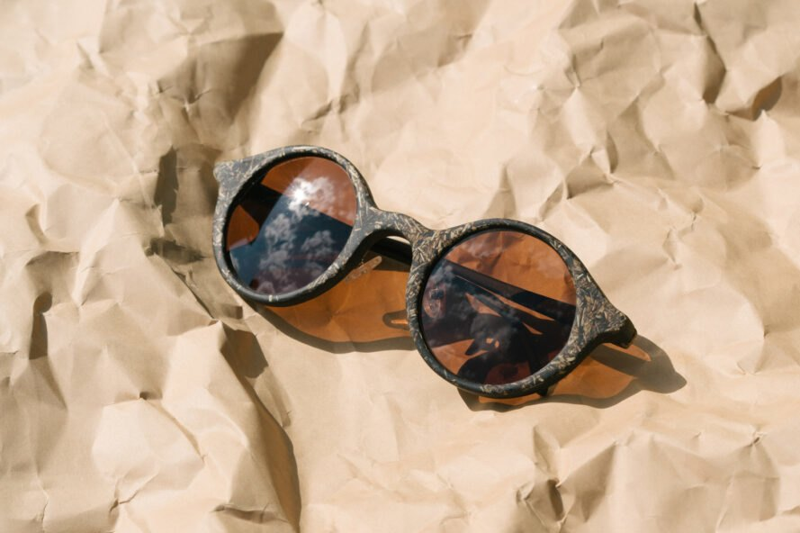 brown sunglasses on crumpled brown paper