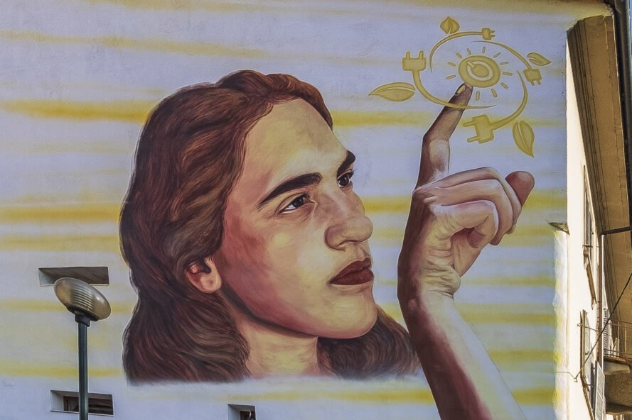 painting of girl touching symbols for clean energy