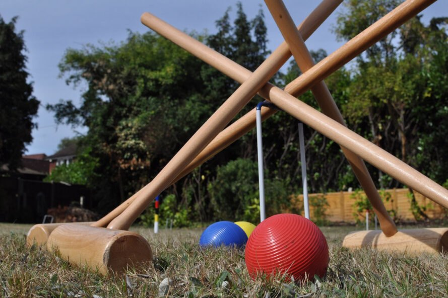 close-up of croquet sport supplies on grassy lawn