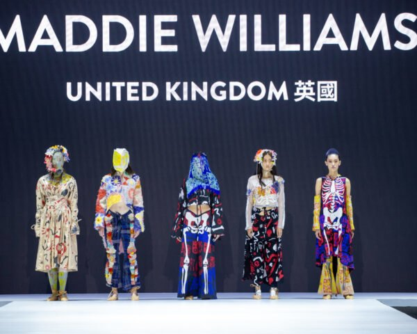 five models in vibrant clothing on catwalk