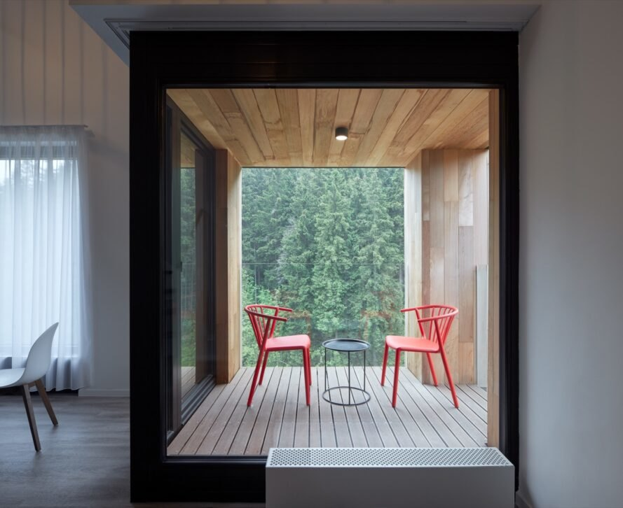 wood deck with two red chairs
