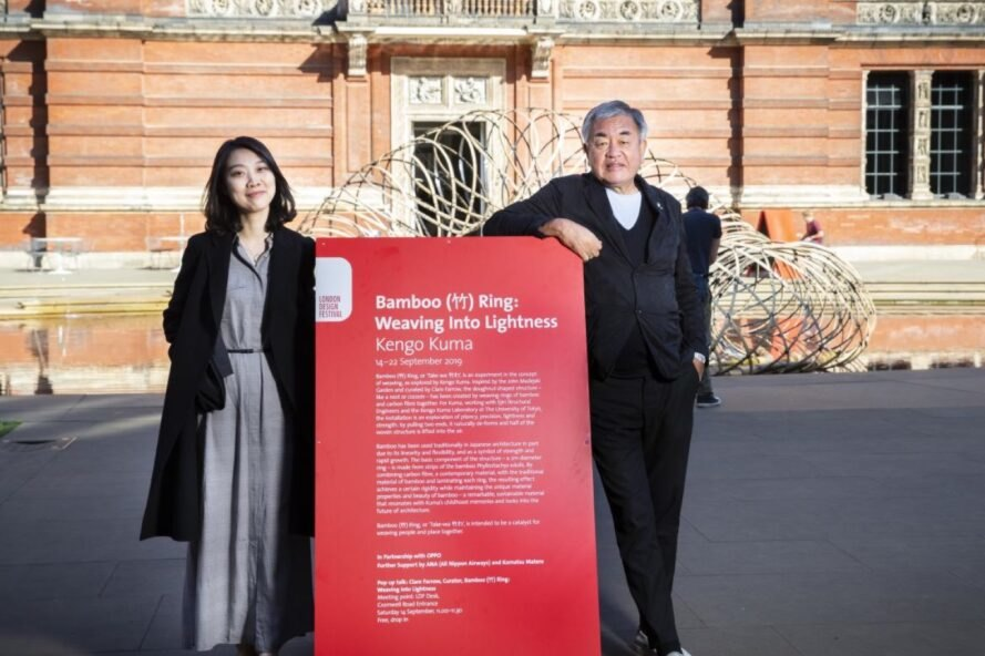 architect Kengo Kuma stands near art installation's descriptive sign