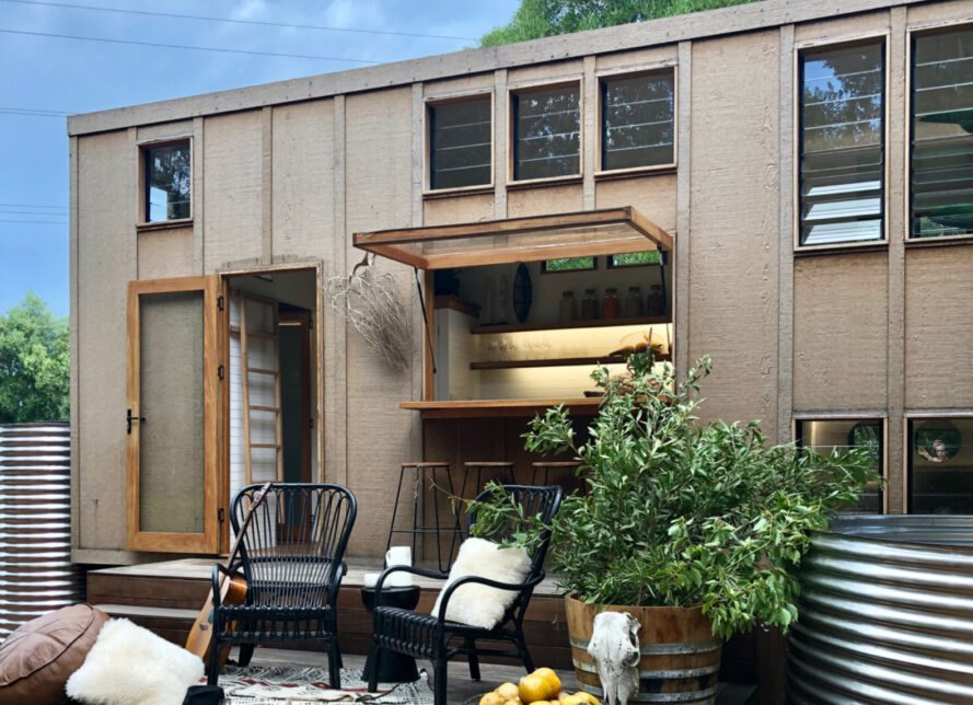 exterior of tiny home with wooden deck