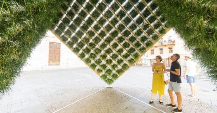Geometric pavilion with an inverted living garden holds court in a