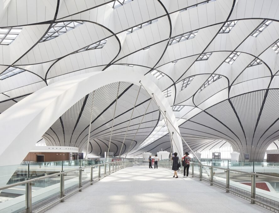 white airport with curving lines on the ceiling
