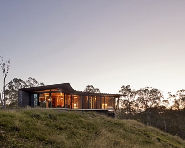 low-lying home with weathered steel roof
