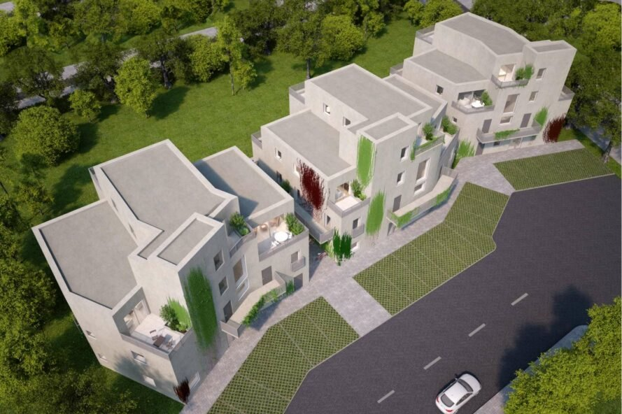 aerial rendering of white block of apartments with green walls