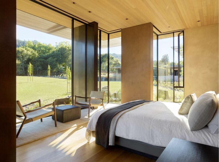 large bedroom with glazed walls