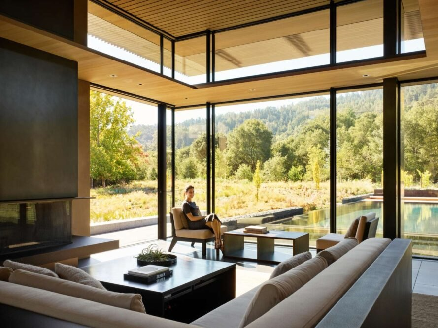 home with an all glass wall looking out over the landscape