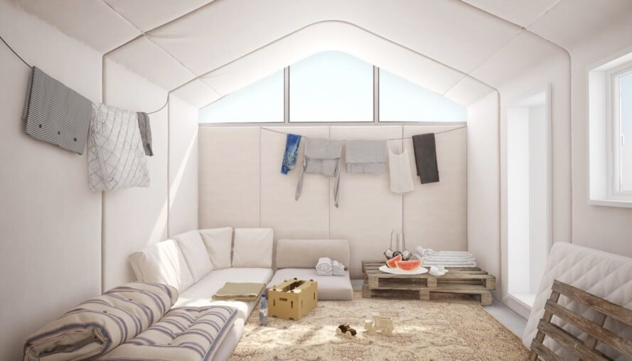 studio living space with white sofa and clothesline for drying clothes