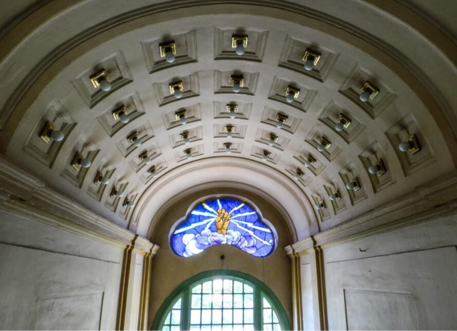 arched entranceway with stained glass window