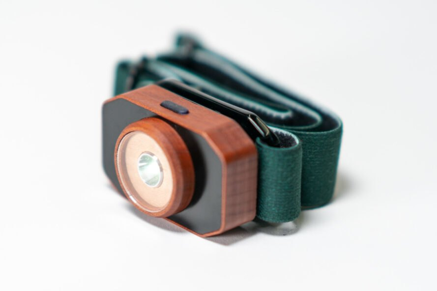 wooden headlamp with green strap