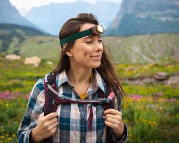 woman wearing headlamp out in the wild