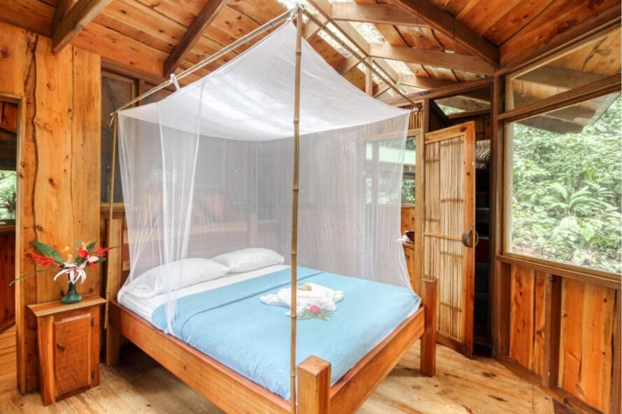 a double sized bed with mosquito netting