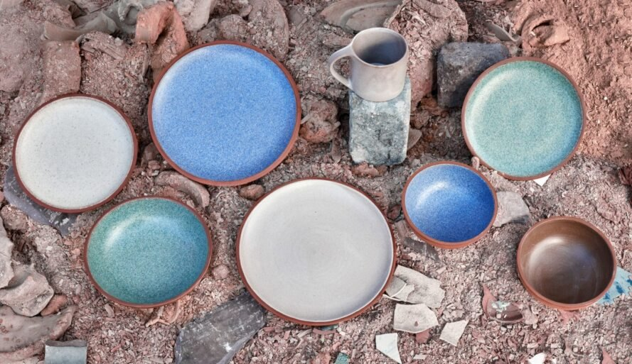 a collection of ceramic dinnerware