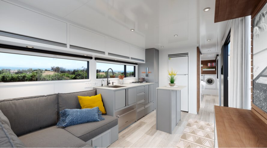 gray sofa and white kitchen in an rv