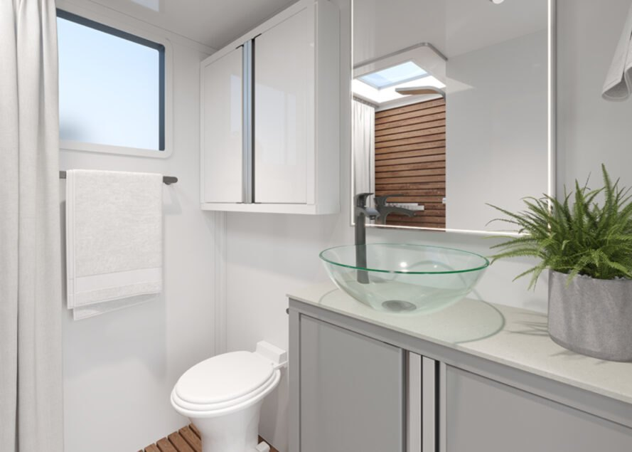 white bathroom with glass bowl sink in an rv