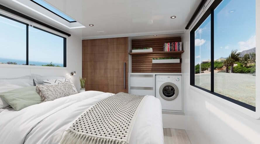 white bed and washer/dryer machine in an rv