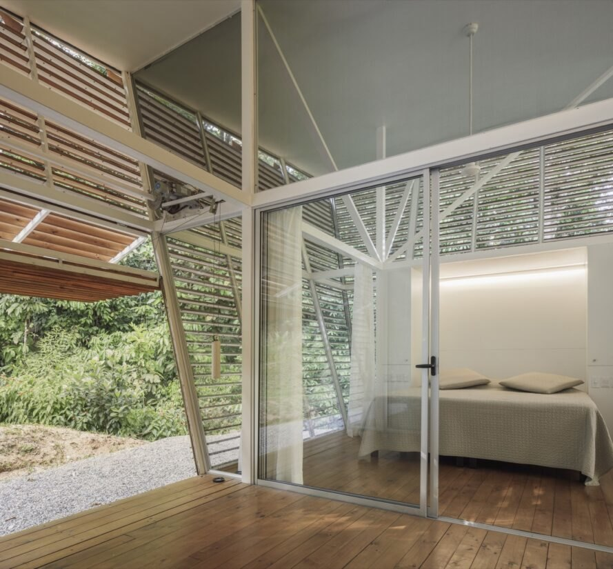 sliding glass door leading to room with a cream bed