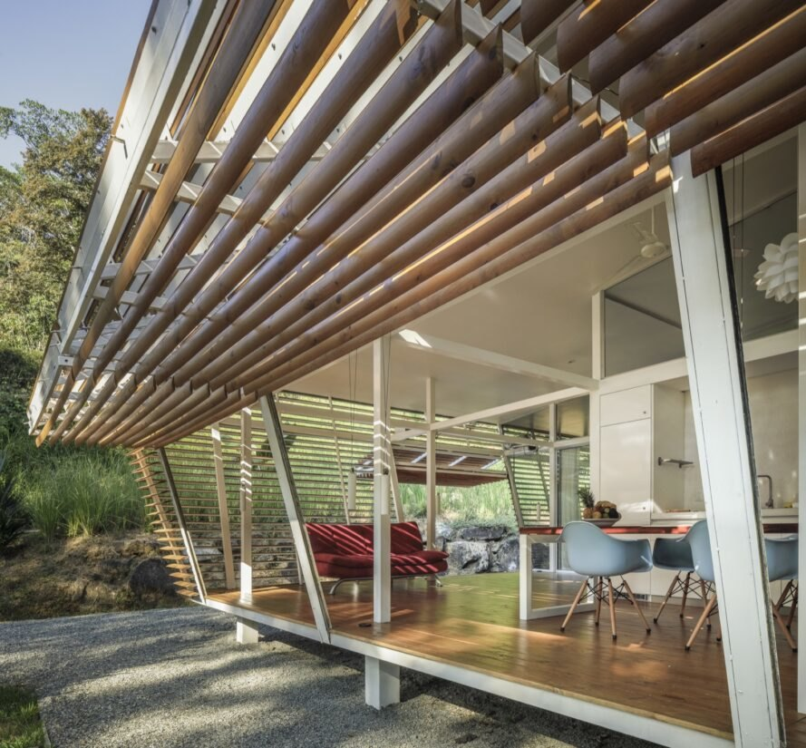 home with wood slatted door open to outdoors