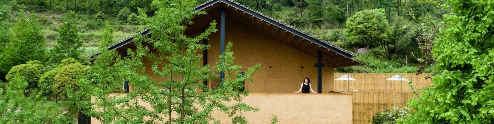 rural eco friendly village built with raw materials surrounded by greenery