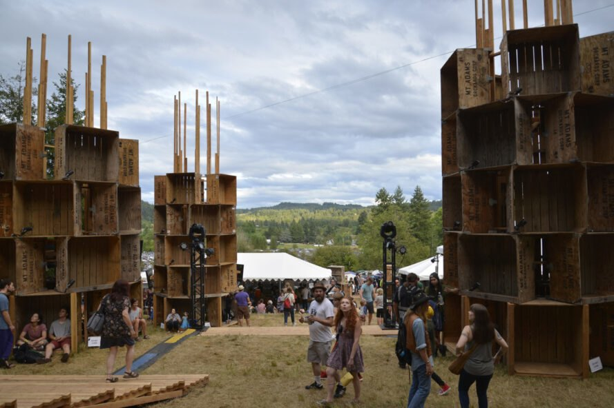 music festival with apple bins placed throughout event