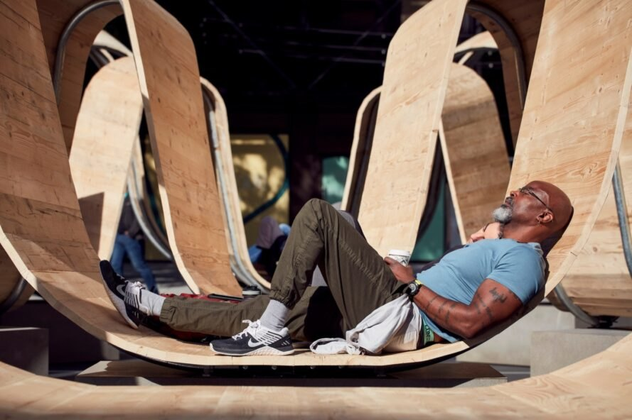 person lying down on wood sculpture