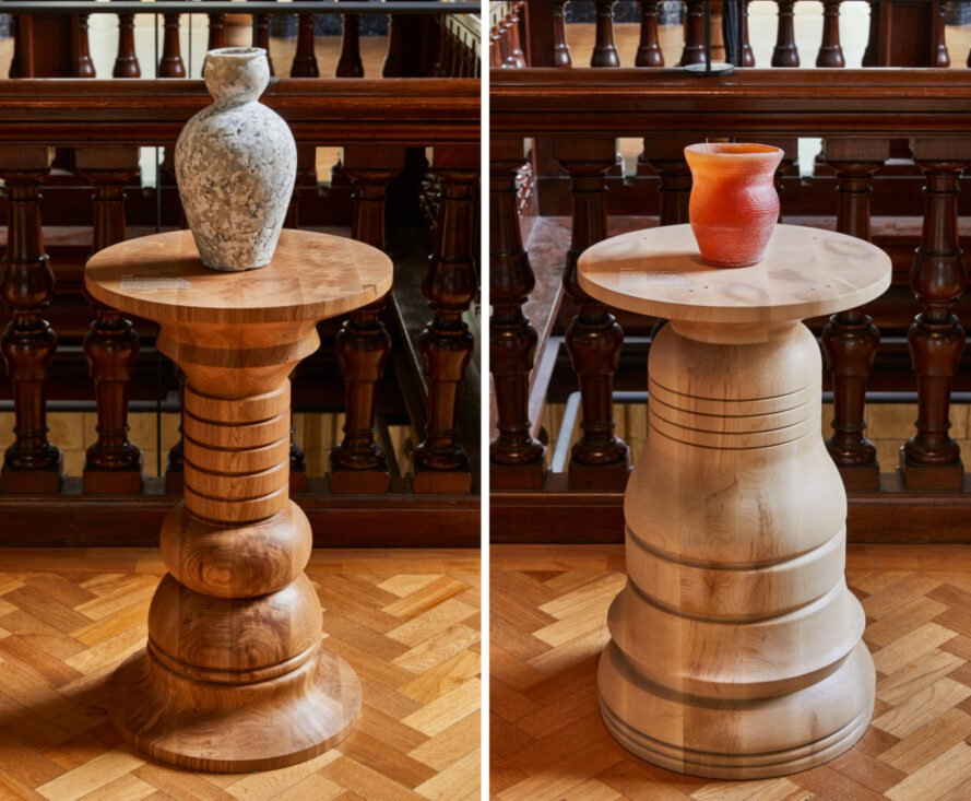 two pedestals with ceramic vases on top
