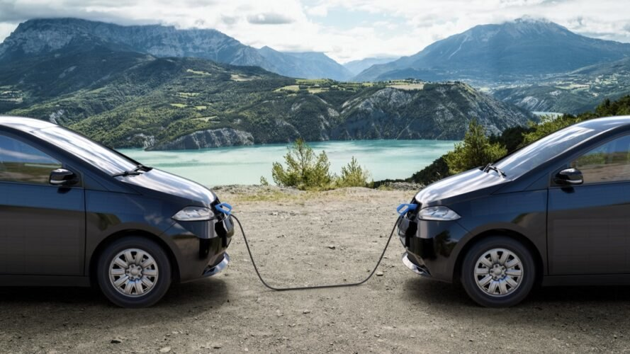 rendering of two electric cars charging each other near a lake