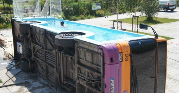 Artist converts old city bus into public swimming pool