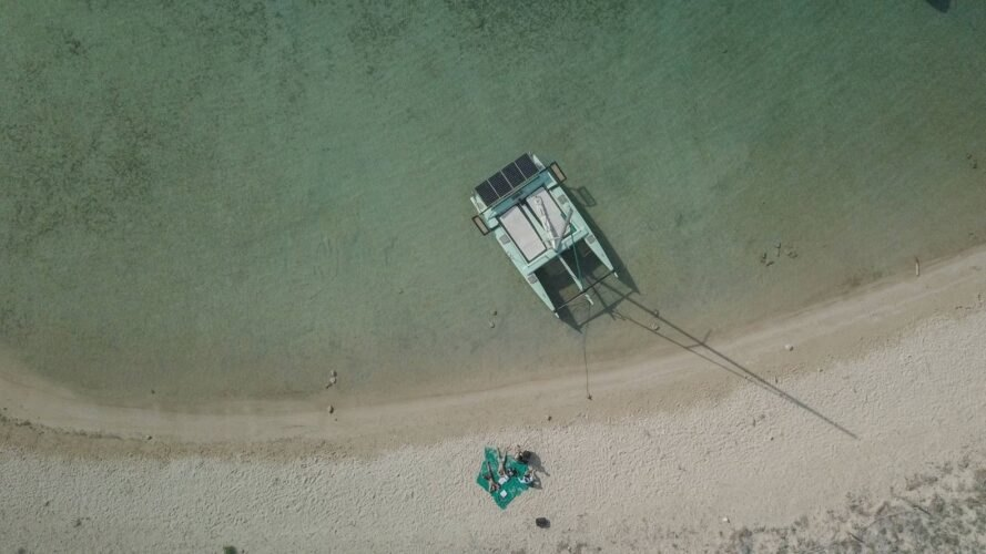 aerial view of green solar-powered boat