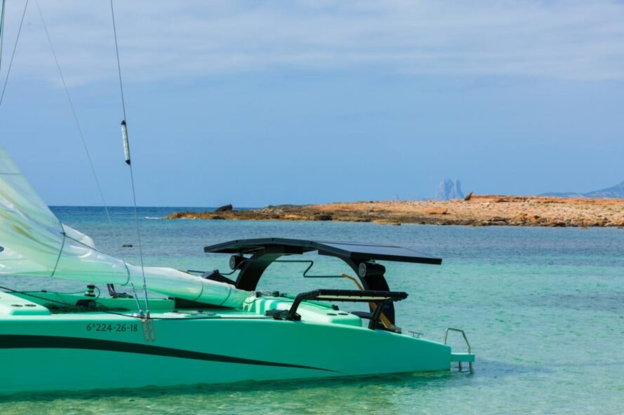 green catamaran at sea