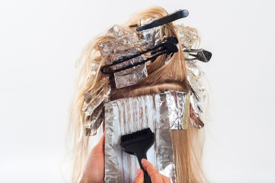 person's hair wrapped in foil sheets