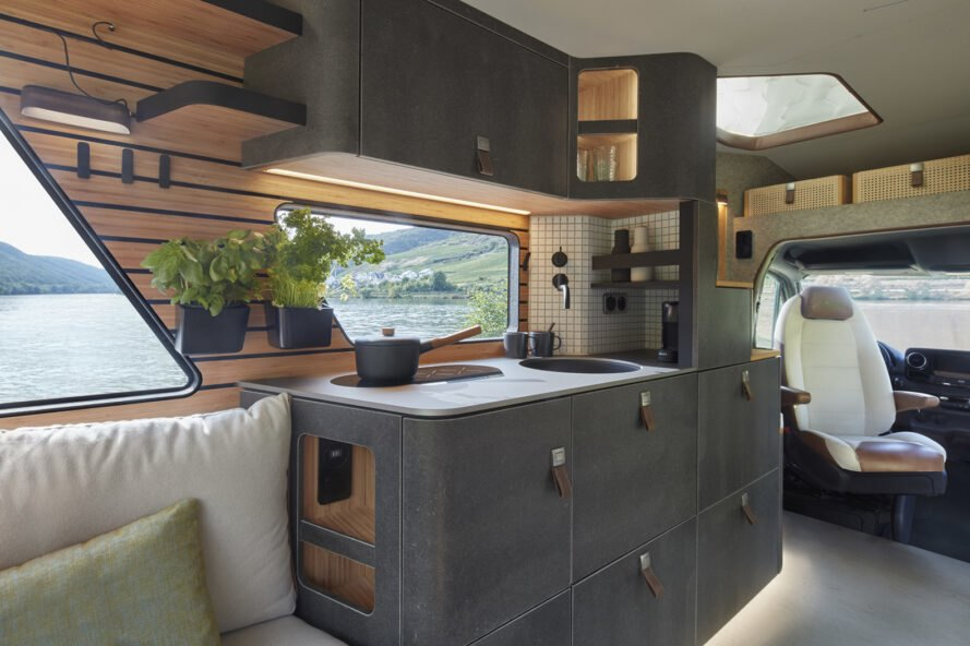 rendering of black kitchen inside a camper van