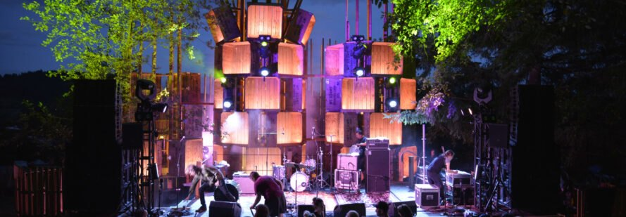 apple bins used for music stage illuminated with lights