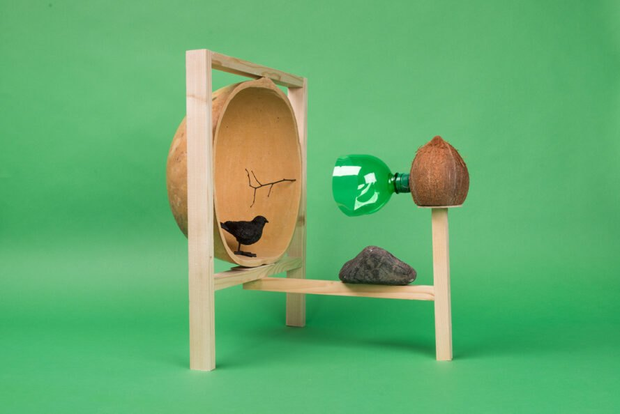 animal shelter made from wood, coconut shell, rock and plastic bottle