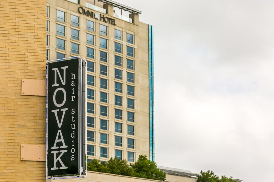 "Building sign that reads ""Novak Hair Studios"""