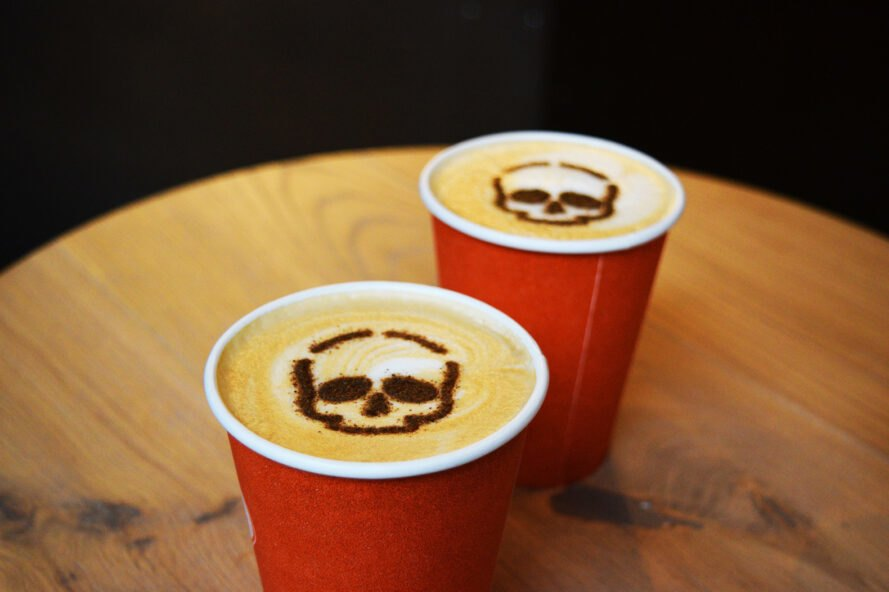 Two lattes with skull latte art