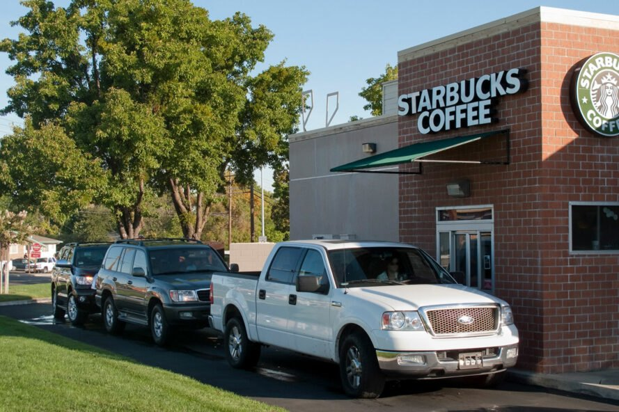 cars idling in drive-thru line at Starbucks