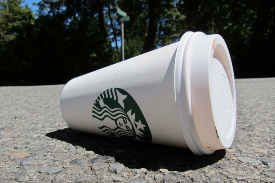 disposable Starbucks cups littered on the ground