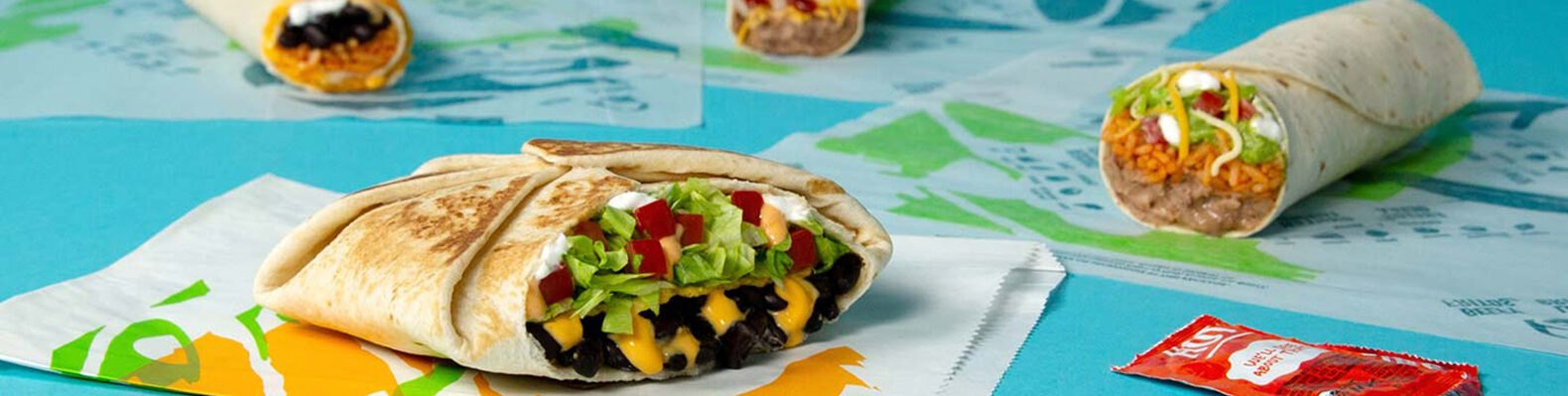 vegetarian burritos and Crunch Wrap on blue background