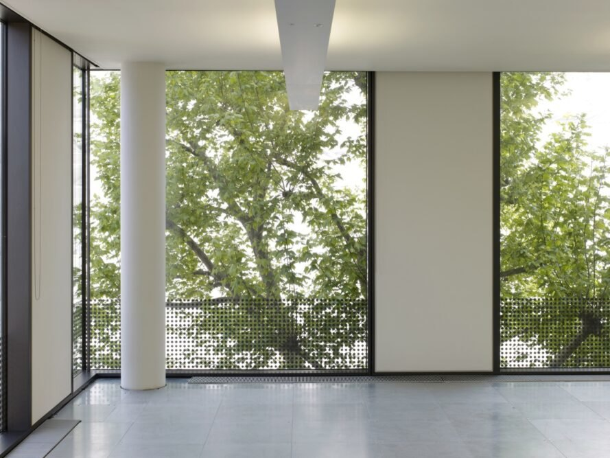 rectangular windows revealing views of trees